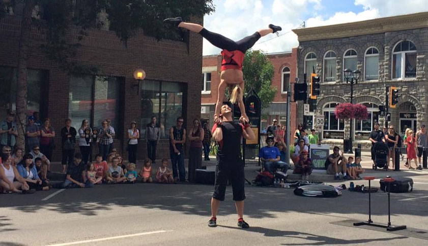 Street performers entertain and audience in downtown Red Deer.