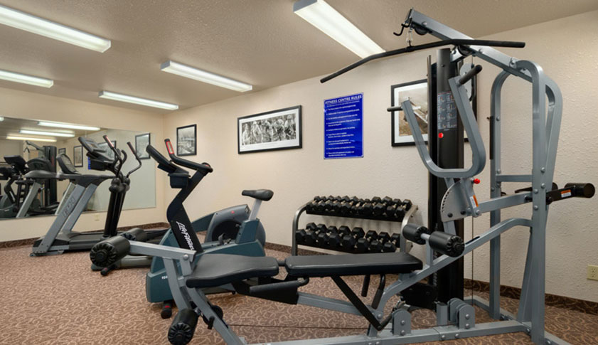 The Fitness Centre is equipped with treadmills, stationary bikes, and free weights for guests at Days Inn Red Deer in Alberta.