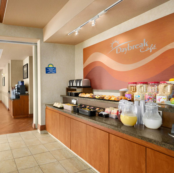 The Daybreak Café at Days Inn Red Deer, Alberta has a breakfast counter stocked with baked goods, fruit, cereal and beverages.