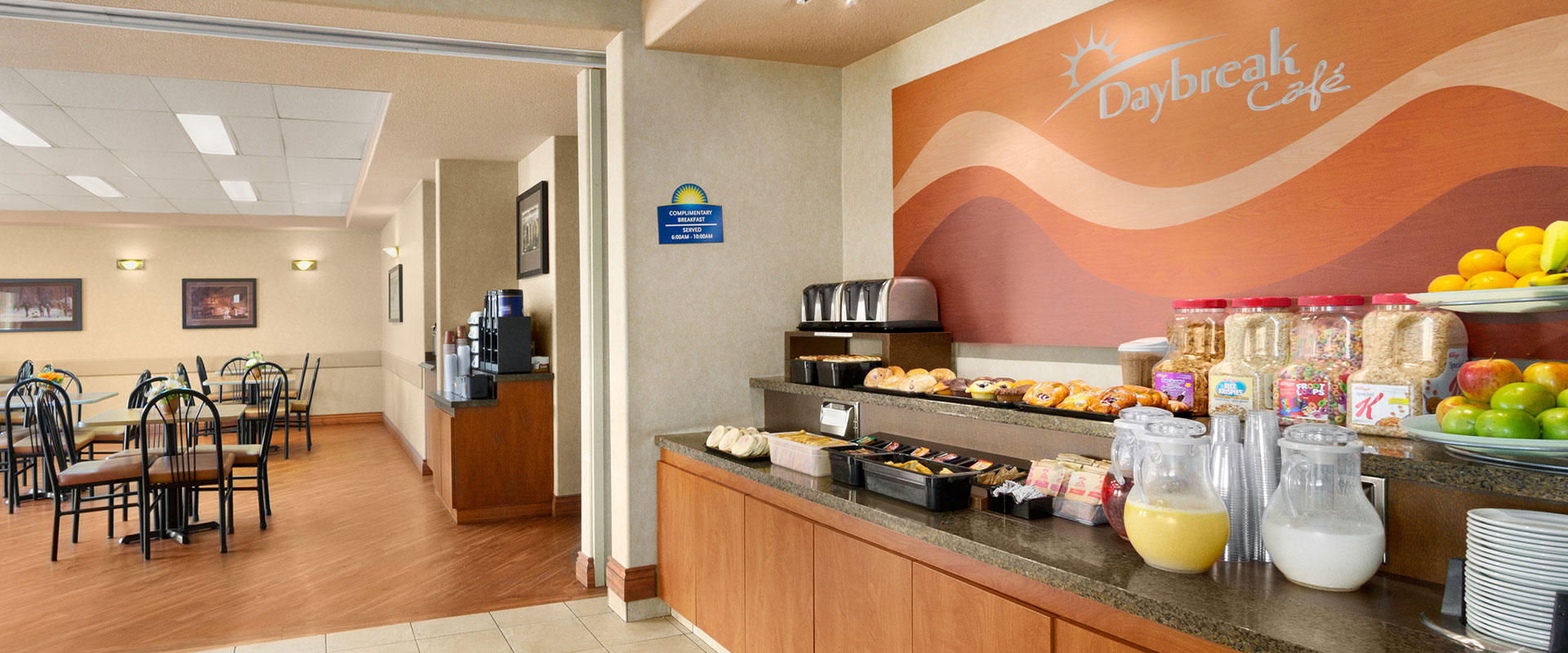 Large view of the breakfast bar at Days Inn Red Deer, Alberta stocked with muffins, danishes, cereals and beverages for guests.