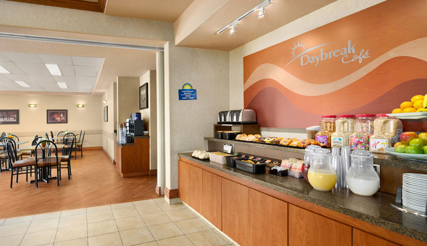The Daybreak Café at Days Inn Red Deer offering a complimentary breakfast of fresh baked goods, cereals, fruits and beverages.